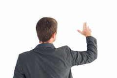 Businessman pointing with his fingers Stock Photos