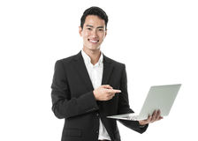 Businessman pointing at his laptop Stock Photography