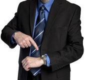 Businessman is pointing at his watch Stock Images