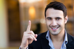 Businessman pointing an idea Royalty Free Stock Photos