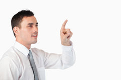 Businessman pointing at invisible screen Stock Photo