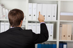 Businessman Pointing At Invisible Screen Royalty Free Stock Photos