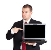 Businessman pointing on laptop Stock Photo