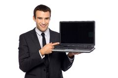 Businessman pointing at laptop Stock Images