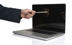 Businessman pointing laptop with a pen Royalty Free Stock Photos