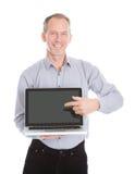 Businessman pointing on laptop stock photo