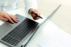 Businessman pointing at laptop Royalty Free Stock Photo