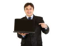 Businessman pointing on laptops blank screen Royalty Free Stock Photo