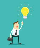 The businessman pointing at light bulb to getting new Idea Stock Photo