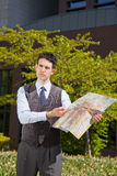 Businessman pointing at a map Royalty Free Stock Image