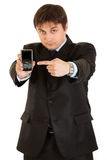 Businessman pointing on mobile with blank screen Royalty Free Stock Image