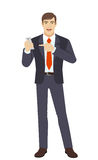 Businessman pointing at a mobile phone Royalty Free Stock Image
