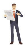 Businessman pointing at newspaper Royalty Free Stock Photography