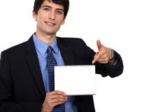 Businessman pointing at a notebook Stock Photos