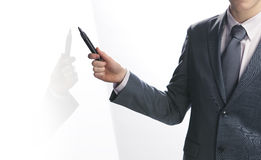 Businessman pointing with a pen Royalty Free Stock Photo