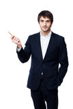 Businessman pointing with pen on white background Royalty Free Stock Photos