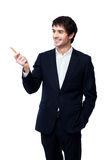 Businessman pointing with pen on white background Stock Photography