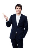 Businessman pointing with pen on white background Royalty Free Stock Image
