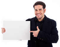 Businessman pointing at the plain board Stock Photo