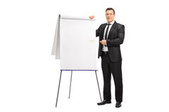 Businessman pointing on a presentation board Royalty Free Stock Images