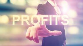 Businessman pointing at PROFITS Stock Photos