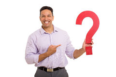 Businessman pointing question mark Royalty Free Stock Photos