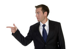 Businessman pointing sideways stock photography