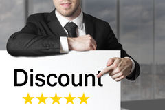 Businessman pointing on sign discount Stock Images