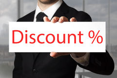 Businessman pointing on sign discount percentage symbol Royalty Free Stock Images