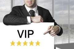 Businessman pointing on sign vip golden stars Stock Photography