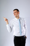 Businessman pointing at something Stock Photography