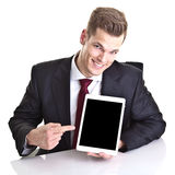 Businessman pointing at space on Tablet-PC Royalty Free Stock Image