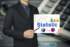 Businessman pointing statistic graph. Stock Photo