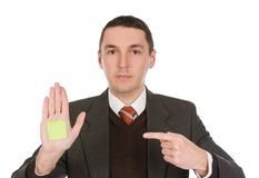 Businessman pointing on sticker Stock Image