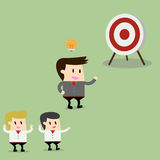 Businessman pointing in a target board. Royalty Free Stock Images