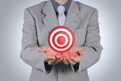 Businessman pointing target symbol as success concept Royalty Free Stock Photos