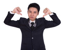 Businessman pointing thumbs down Royalty Free Stock Images