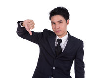 Businessman pointing thumbs down Royalty Free Stock Photo