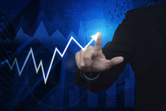 Businessman pointing to arrow business chart and graph over map Stock Photography