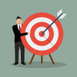 Businessman pointing to the big target Royalty Free Stock Images