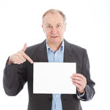 Businessman pointing to blank card Royalty Free Stock Images