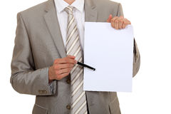 Businessman pointing to blank paper Stock Photo