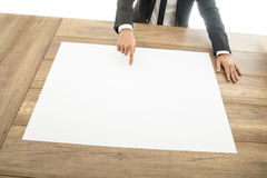Businessman pointing to a blank placard stock photos