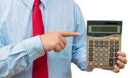 Businessman pointing to calculator on white background Royalty Free Stock Photography