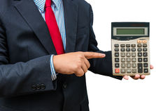 Businessman pointing to calculator on white background Stock Photo