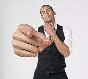 Businessman pointing  to the camera. A studio portrait of a young businessman pointing  to the camera Stock Photos