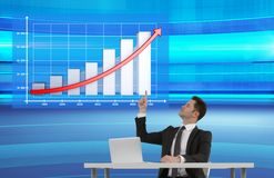 Businessman pointing to chart Royalty Free Stock Image