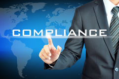 Businessman pointing to COMPLIANCE word Royalty Free Stock Photo