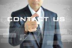 Businessman pointing to CONTACT US sign. Businessman pointing to CONTACT US words on virtual screen Stock Photos