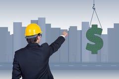 Businessman pointing to dollar symbol Stock Photo